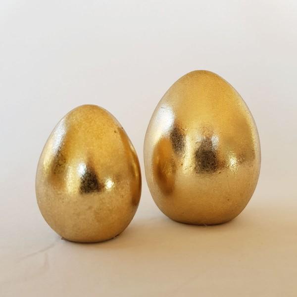 2 Deko Eier, gold, Höhe 7 cm und 9 cm